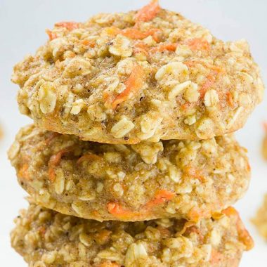 Carrot Cake Oatmeal Cookies are soft and tender. They are like classic carrot cake transformed into easy and healthy cookies. In order to make clean eating breakfast cookies, these simple recipe use only healthy ingredients: oatmeal, whole wheat flour, carrots and honey. Needless to say that whole wheat flour is much healthier than regular white flour. Also using honey as a natural sweetener is way much better than refined white sugar. Carrot Cake Oatmeal Cookies are such a fun way to eat grains for breakfast. Besides grain, these cookies are loaded with carrots. This way you can trick your kids into eating some veggies, too. Kids won't skip cookies, right?! Prep Time: 10 minutes Cook Time: 12 minutes Yield: 24 cookies Ingredients 1 cup instant oats (as a substitute you can use old fashioned rolled oats pulsed a few times in a food processor) ¾ cup whole wheat flour 1 ½ tsp baking powder 1–1 ½ tsp ground cinnamon (to taste) Dash of salt 2 tablespoons coconut oil-melted and cooled 1 egg 1 teaspoon vanilla ½ cup honey 1 cup grated carrots Instructions Whisk together instant oats, flour, baking powder, cinnamon, and salt, set aside. In a large bowl whisk together egg, vanilla and coconut oil. Add honey and stir to combine. Stir in dry ingredients mixture, then fold in carrots. Cover the dough with plastic wrap and chill for 1 hour. CHILLING IS MANDATORY!!! The oats need some time to soak some moisture, also prevent cookies from flatten completely. Preheat the oven to 350 F, line large baking sheet with parchment paper and set aside. Using ice cream scoop drop the ball of cookie dough onto baking sheet leaving two inch space apart. If you chill the dough longer and the dough is very thick flatten the cookies slightly before baking. Bake for 11-13 minutes. Cool the cookies on a baking sheet for 15 minutes ( they need to finish cooking on warm baking sheet) then transfer to a rack.